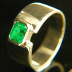 0.74 carat sandawana emerald in gold ring