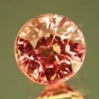 Round Precision Cut Padparadscha round certified untreated brilliant cut