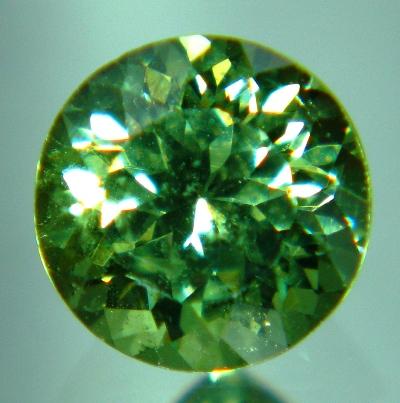 round solitary sparkly demantoid in best green