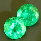 pair round emeralds brilliant cut